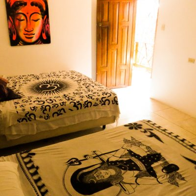 private queen room, buddha artwork, buddha bed cover